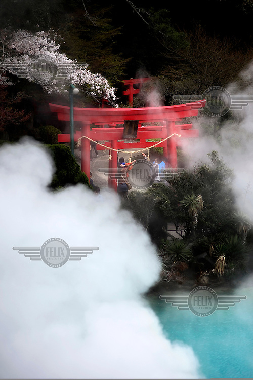Steam rises around a Tori Gate from the Umi Jigoki hot spring (Sea Hell), in Kannawa in Beppu. This resort town contains nine major geothermal hot spots, which are sometimes referred to as the 'Nine Hells of Beppu'. /Felix Features