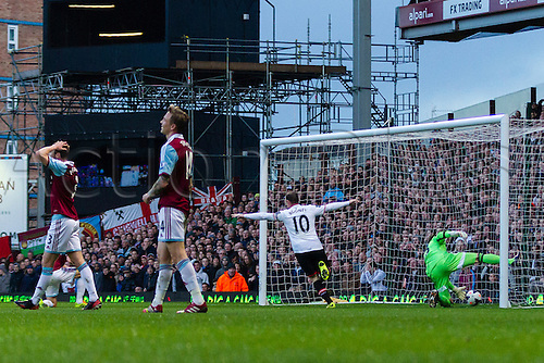 22.03.2014  London, England.  Manchester United's Wayne ROONEY scores his second goal after Nolan cleared the ball directly to him during the Premier League game between West Ham United and Manchester United from the Boleyn Ground, Upton Park .