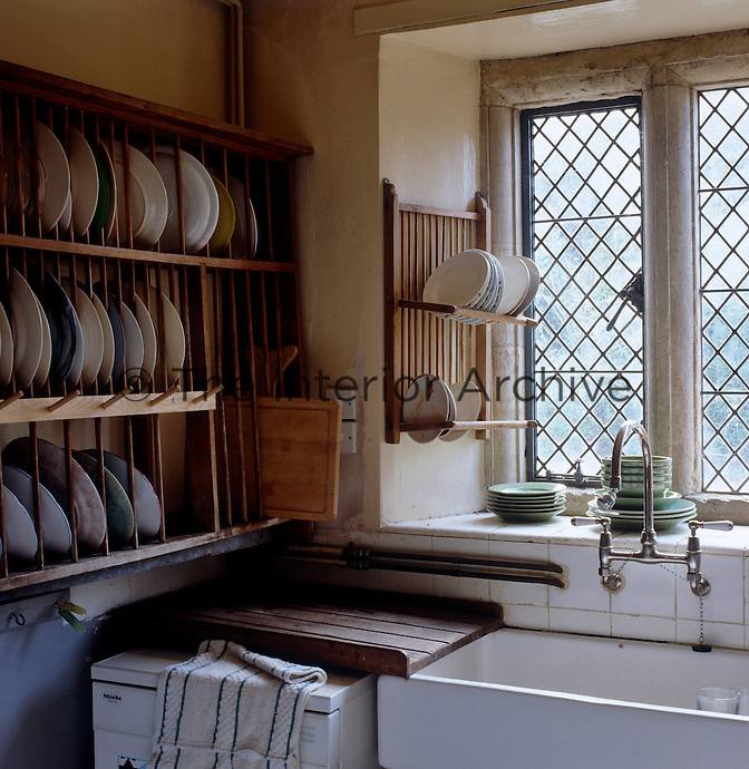 The old fashioned scullery still contains the original plate rack from Mitford days next to a stone butler's sink under the mullioned window
