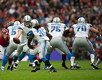 26.10.2014.  London, England.  NFL International Series. Atlanta Falcons versus Detroit Lions. Lions' QB Matthew Stafford [9] hands off the ball to Lions' RB Joique Bell [35].