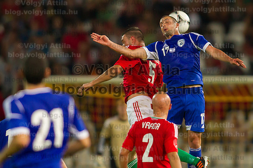 Hungary's Norbert Meszaros (top 2nd R) and Israel's Ben Sahar (top R) go for a header during a friendly football match Hungary playing against Israel in Budapest, Hungary on August 15, 2012. ATTILA VOLGYI