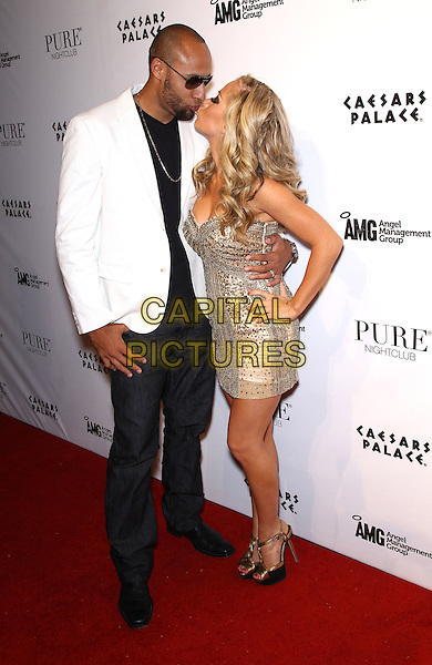 Hank Baskett & Kendra Wilkinson-Baskett.celebrates her 26th birthday at Pure Nightclub inside Caesars Palace Las Vegas, Nevada, USA..11th June 2011.full length beige silver gold strapless dress hand on hip beads beaded jeans denim white jacket sunglasses shades married husband wife profile kiss kissing .CAP/ADM/MJT.© MJT/AdMedia/Capital Pictures.
