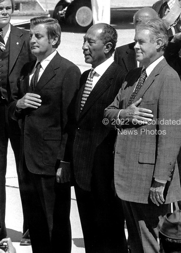 United States Vice President Walter Mondale, left, and U.S. Secretary of State Cyrus Vance, right, welcome President Anwar Sadat of Egypt, center, at Andrews AFB outside Washington on September 5, 1978.  Sadat arrived at Andrews prior to travelling to Camp David to meet U.S. President Jimmy Carter and Prime Minister Menachem Begin of Israel for a Middle East Summit..Credit: Arnie Sachs / CNP