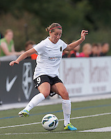 Portland Thorns FC forward Danielle Foxhoven (9) dribbles. In a National Women's Soccer League (NWSL) match, Boston Breakers (blue) defeated Portland Thorns FC (white/black), 2-1, at Dilboy Stadium on August 7, 2013.