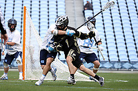 CHAPEL HILL, NC - MARCH 10: Logan McGovern #1 of Bryant University is wrapped up by Cam Macri #28 of the University of North Carolina during a game between Bryant and North Carolina at Dorrance Field on March 10, 2020 in Chapel Hill, North Carolina.