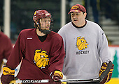 Kyle Schmidt (Duluth - 7), Bill Watson (Duluth - Volunteer Assistant Coach) - The University of Minnesota-Duluth Bulldogs practiced on Friday morning, April 8, 2011, during the 2011 Frozen Four at the Xcel Energy Center in St. Paul, Minnesota.