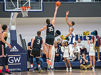WASHINGTON, DC - JANUARY 29: Luka Brajkovic #35 of Davidson reaches up to block  shot by Armel Potter #2 of George Washington during a game between Davidson and George Wshington at Charles E Smith Center on January 29, 2020 in Washington, DC.