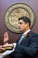TALLAHASSEE, FLA. 11/18/14-ORGSESS111814CH-House Speaker Steve Crisafulli, R-Merritt Island, takes the oath of office during Organizational Session, Nov. 18, 2014 at the Capitol in Tallahassee.<br /> <br /> COLIN HACKLEY PHOTO