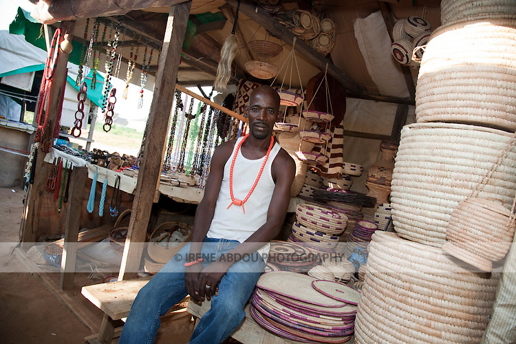 A Fulani man sells handicrafts, including woven baskets and calabash covers, in the Nigerian capital of Abuja.