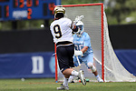 DURHAM, NC - APRIL 30: Notre Dame's Brendan Gleason (9) fires a shot past UNC's Brian Balkam (30) for a goal. The University of North Carolina Tar Heels played the University of Notre Dame Fighting Irish on April 30, 2017, at Koskinen Stadium in Durham, NC in a 2017 ACC Men's Lacrosse Tournament Championship match. UNC won the game 14-10.
