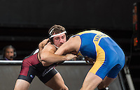 STANFORD, CA - December 17, 2015: The Stanford Cardinal wrestling team competes against Cal State University Bakersfield at Maples Pavilion. Final score Stanford 16, CSU Bakersfield 22.