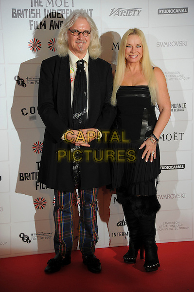 Billy Connolly, Pamela Stephenson.Independent Film Awards, Old Billingsgate Market, London, England..December 9th, 2012.full length black dress pleats pleated fur trim boots blue plaid tartan trousers glasses jacket tie goatee facial hair married husband wife.CAP/CAS.©Bob Cass/Capital Pictures.