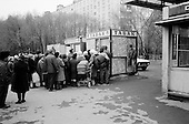 Moscow, Russia<br /> October 22, 1992<br /> <br /> People purchase cigarettes, for resale, at a kiosk near Kievski train station.<br /> <br /> In December 1991, food shortages in central Russia had prompted food rationing in the Moscow area for the first time since World War II. Amid steady collapse, Soviet President Gorbachev and his government continued to oppose rapid market reforms like Yavlinsky's &quot;500 Days&quot; program. To break Gorbachev's opposition, Yeltsin decided to disband the USSR in accordance with the Treaty of the Union of 1922 and thereby remove Gorbachev and the Soviet government from power. The step was also enthusiastically supported by the governments of Ukraine and Belarus, which were parties of the Treaty of 1922 along with Russia.<br /> <br /> On December 21, 1991, representatives of all member republics except Georgia signed the Alma-Ata Protocol, in which they confirmed the dissolution of the Union. That same day, all former-Soviet republics agreed to join the CIS, with the exception of the three Baltic States.
