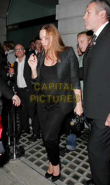 STELLA McCARTNEY .The Established & Sons Gallery Opening, London, England..October 11th, 2007 .full length black trousers bag purse beads beaded grey gray jacket suit pregnant see through thru .CAP/AH.©Adam Houghton/Capital Pictures.