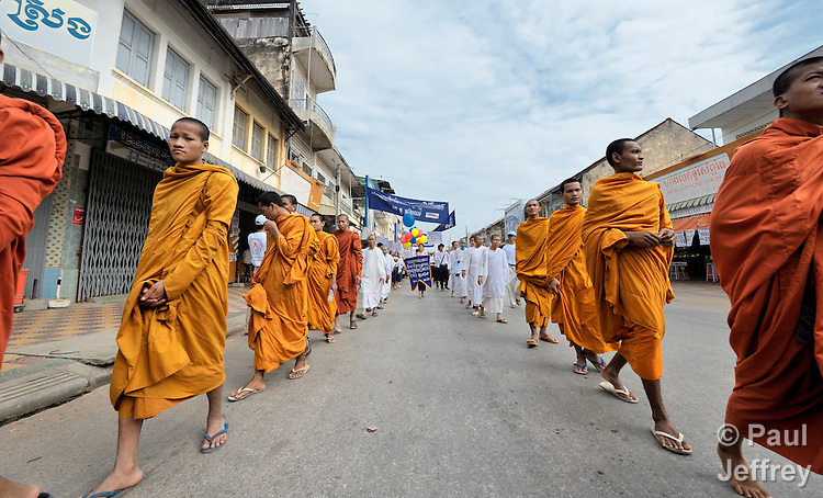 Buddhist monks participate in a march to commemorate World AIDS Day held in Battambang, Cambodia. Among sponsors of the march was the Salvation Centre Cambodia, an organization that works with Buddhist monks and other activists to foster support for people living with HIV and AIDS as well as public education and advocacy throughout the country.