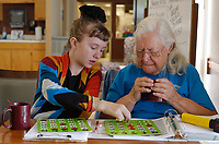 NWA Democrat-Gazette/DAVID GOTTSCHALK  Dakota Seratt, 10, of Van Buren, helps Thursday, March 22, 2018, her grandmother Almeda Allen, the volunteer desk attendant at the Farmington Senior Activity and Wellness Center. watch her cards during bingo at the center. John Gibson called the bingo games that are played every Thursday at the center.