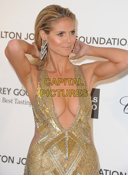 Heidi Klum (wearing Julien Macdonald).The 21st Annual Elton John AIDS Foundation Academy Awards Viewing Party held at The City of West Hollywood Park in West Hollywood, California, USA..February 24th, 2013.oscars half length gold diamante sequins sequined dress beads beaded art deco plunging neckline cleavage hands arms rings armpits .CAP/DVS.©DVS/Capital Pictures.