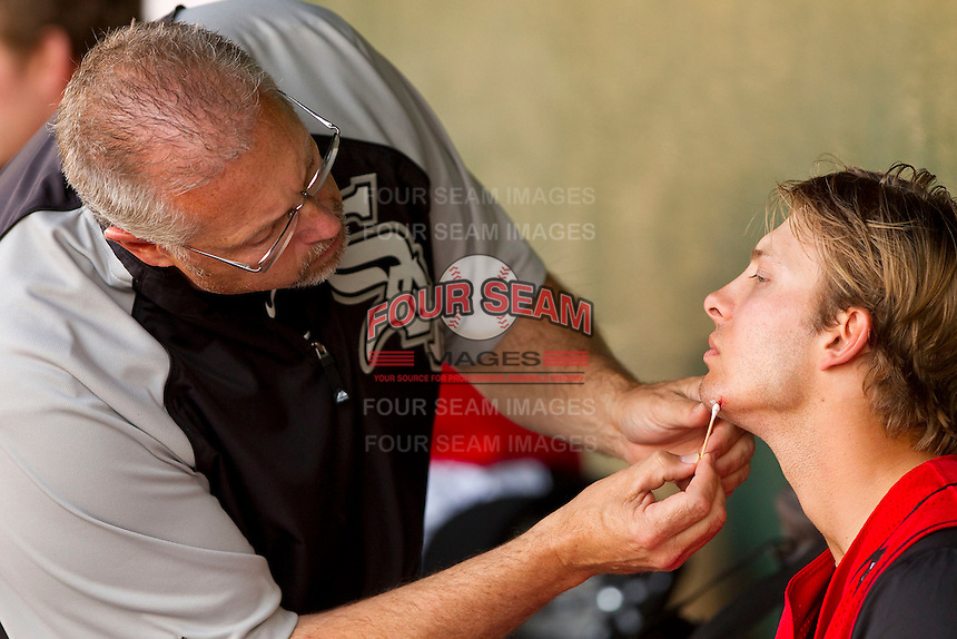 "Kannapolis Intimidators trainer Scott ""Fargo"" Johnson works on Ross Wilson #2 during a game against the Hickory Crawdads at Fieldcrest Cannon Stadium on April 17, 2011 in Kannapolis, North Carolina.   Photo by Brian Westerholt / Four Seam Images"