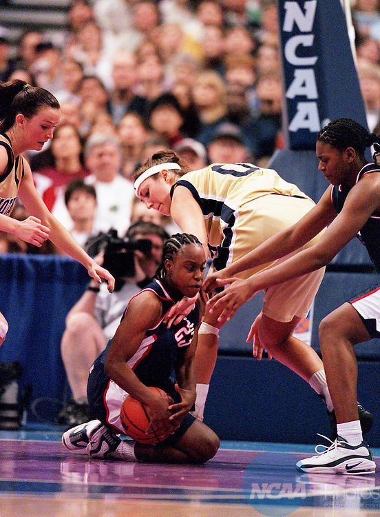 30 MAR 2001:  Guard Kennitra Johnson (23) of the University of Connecticut dives for a loose ball against Notre Dame during the Division 1 Women's Basketball Semifinals held at the Savvis Center in St. Louis, MO.  Notre Dame defeated UCONN 90-75 to advance to the national championship game.  Jamie Schwaberow/NCAA Photos