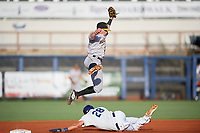 Bradenton Marauders second baseman Mitchell Tolman (6) jumps to catch an errant throw from the catcher on a stolen base attempt as Josh Lowe (28) slides into second base during a game against the Charlotte Stone Crabs on August 6, 2018 at Charlotte Sports Park in Port Charlotte, Florida.  Charlotte defeated Bradenton 2-1.  (Mike Janes/Four Seam Images)