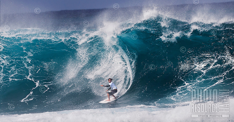 Surfer in the pipe at the Banzai Pipeline on North Shore of O'ahu.