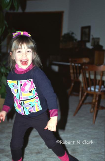 Cute girl running past camera smiling