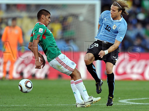 22 06 2010  Diego Forlan r of Uruguay vies with A Player of Mexico during their 2010 World Cup Group A Soccer Match AT Royal Bafokeng Stage in Rustenburg