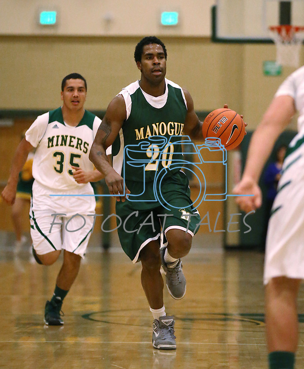 Alumni Kenneth Viser competes in the alumni game at the Wild West Shootout at Bishop Manogue High School in Reno, Nev., on Wednesday, Dec. 4, 2013. The Miners defeated the alumni 79-62. <br /> Photo by Cathleen Allison