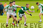 Dave Culloty and Podge O'Sullivan Na Gaeil in action against Paul O'Donoghue Legion in the Kerry County League in Tralee on Saturday evening.