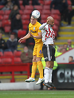 Preston North End's Ben Davies jumps with Sheffield United's David McGoldrick<br /> <br /> Photographer Mick Walker/CameraSport<br /> <br /> The EFL Sky Bet Championship - Sheffield United v Preston North End - Saturday 22 September 2018 - Bramall Lane - Sheffield<br /> <br /> World Copyright © 2018 CameraSport. All rights reserved. 43 Linden Ave. Countesthorpe. Leicester. England. LE8 5PG - Tel: +44 (0) 116 277 4147 - admin@camerasport.com - www.camerasport.com