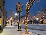 Idaho, Northern, Kootenai County, Coeur d'Alene. Sherman Avenue in the pre-dawn light of winter after a fresh snowfall.