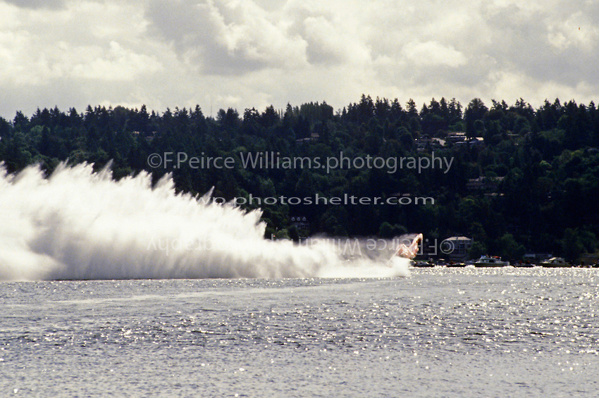 """Frame 3: Chip Hanauer speeds into turn one in the U-1 """"Miss Budweiser T-3"""" where the right sponson lifts skyward and the boat blows over. Hanauer escaped injury in the accident."""