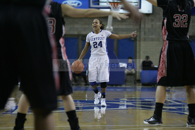 Senior point guard Amber Smith dribbles the ball during the second half of UK Women's Basketball game vs. Northeastern University at Memorial Coliseum in Lexington, Ky., on Thursday, Nov. 17, 2011. Photo by Tessa Lighty | Staff