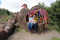 Pictured: Artist Gwen Heeney with her son Valentine Kuhl and grandson Aurora Jorge-Kuhl, by her creation, the mythical beast Saturday 13 August 2016<br />Re: Grow Wild event at  Furnace to Flowers site in Ebbw Vale, Wales, UK