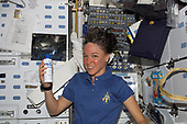 FILE: In this photo released by NASA, Astronaut Lisa M. Nowak, STS-121 mission specialist, washes her hair on the middeck of the Space Shuttle Discovery while docked with the International Space Station in Earth orbit on July 13, 2006.<br /> Credit: NASA via CNP