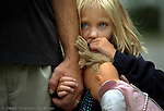 """Connie Jo """"CJ"""" Couillard, age 6, squeezes her fathers hand and holds a doll as she listens to her parents talk with church elders about staying there. The church ended up feeding the family and putting them up in a motel for two nights."""