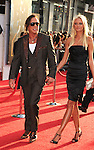 "HOLLYWOOD, CA. - April 26: Mickey Rourke and Anastassija Makarenko arrive at the ""Iron Man 2"" World Premiere held at the El Capitan Theatre on April 26, 2010 in Hollywood, California."
