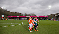 The teams pre match handshakes during the Sky Bet League 2 match between Wycombe Wanderers and Luton Town at Adams Park, High Wycombe, England on 6 February 2016. Photo by Andy Rowland.
