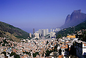 Rio de Janeiro, Brazil. Aerial view of favela Rocinha with the wealthy beach resort of Sao Conrado behind; rich-poor contrast.