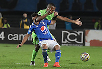 BOGOTA - COLOMBIA -27 -11-2016: Maximiliano Nuñez (Izq) jugador de Millonarios disputa el balón con Edwin Velasco (Der) jugador de Atlético Nacional durante partido de ida por los cuartos de final de la Liga Aguila II 2016 jugado en el estadio Nemesio Camacho El Campin de la ciudad de Bogota./ Maximiliano Nuñez (L) player of Millonarios fights for the ball with Edwin Velasco (R) player of Atletico Nacional during first leg match for the final quarters of the Liga Aguila II 2016 played at the Nemesio Camacho El Campin Stadium in Bogota city. Photo: VizzorImage / Gabriel Aponte / Staff.