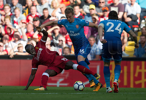 27th August 2017, Anfield, Liverpool, England; EPL Premier League football, Liverpool versus Arsenal; Sadio Mane of Liverpool is fouled by a strong challenge from Rob Holding of Arsenal