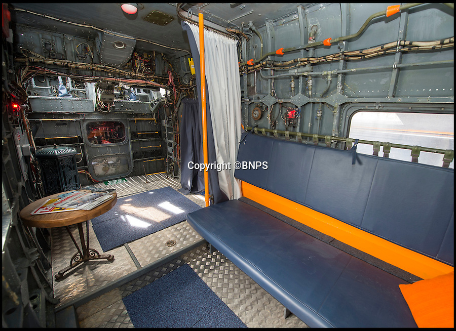 BNPS.co.uk (01202 558833)<br /> Pic: PhilYeomans/BNPS<br /> <br /> Cabin with two bedrooms to the side and in the tail....<br /> <br /> Ultimate Heli-pad for a holiday - Campsite owner Stewart Dungey is hoping his new venture takes off - after turning a decommissioned Royal Navy helicopter into a unique holiday let.<br /> <br /> Stewart has spent &pound;30,000 buying, transporting and converting a Cold War Westland Wessex chopper on his farm on the Isle of Wight<br /> <br /> With an Airstream caravan kitchen annex one side and a bedroom pod on the other the chopper now provides luxury accomodation for adventurous families.