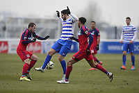 Shaun Maloney of Chicago Fire tackles Adel Taarabt of QPR
