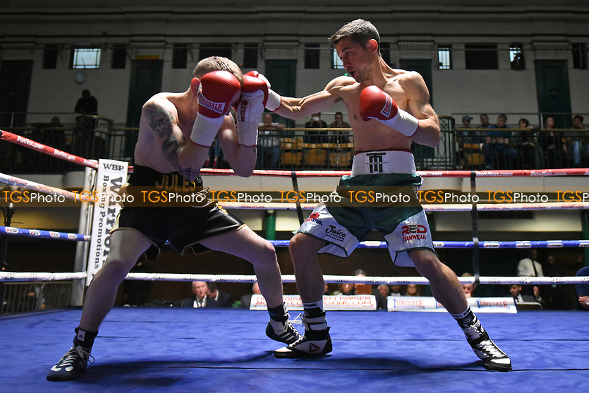 Tom McGinley (geen/white shorts) defeats Jules Phillips during a Boxing Show at York Hall on 8th April 2017