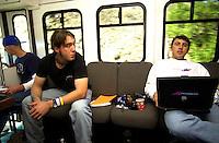 "Paul Menard (L) and Kinnon Marshall ride the Team Gordon ""Fun Bus"" to the next refueling stop for Robby Gordon's Trophy Truck..SCORE Baja 2000, Ensenada, Baja California, Mexico.12-14 November,2000 copyright©F.Peirce Williams 2000...F. Peirce Williams .photography.P.O.Box 455 Eaton, OH 45320.p: 317.358.7326  e: fpwp@mac.com."