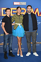 "Tom Holland, Zendaya and director, Jon Watts<br /> at the ""Spider-Man:Homecoming"" photocall at the Ham Yard Hotel, London. <br /> <br /> <br /> ©Ash Knotek  D3281  15/06/2017"