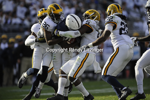 21 November 2015:  Michigan CB Jourdan Lewis (26) and Michigan S Jabrill Peppers (5) tackle Penn State WR Chris Godwin (12). The Michigan Wolverines defeated the Penn State Nittany Lions 28-16 at Beaver Stadium in State College, PA. (Photo by Randy Litzinger/Icon Sportswire)