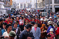 THE BARKHOR a TIBETAN Bazaar is flooded with TIBETANS making their evening KORA around the Jokhang Temple - LHASA, TIBET