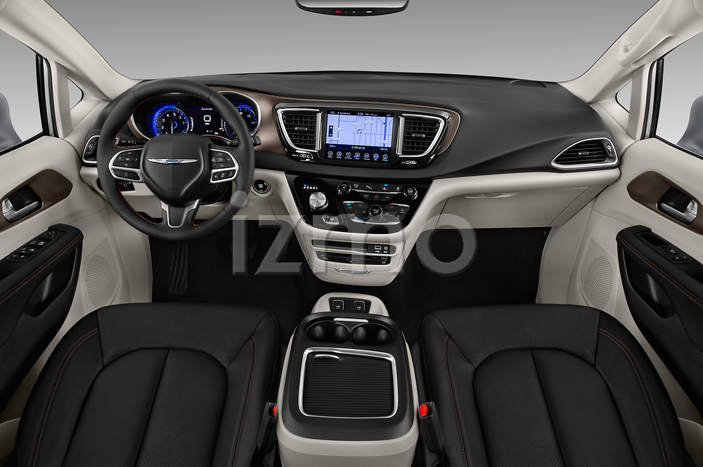 Stock photo of straight dashboard view of a 2018 Chrysler Pacifica Touring-L Plus 5 Door Mini Van