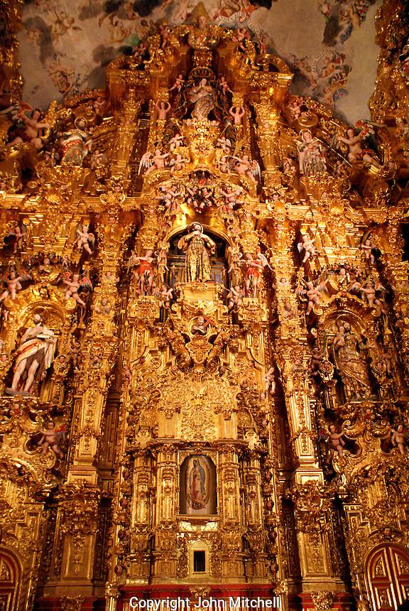 The main altarpiece in the Iglesia de San Francisco Javier Church in Tepotzotlan, Mexico. The San Francisco Javier Church and adjoining former Jesuit monastery now house the National Museum of the Viceroyalty or Museo Nacional de Virreinato.